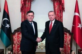 President of Turkey Erdogan meets Fayez Al-Sarraj- – ISTANBUL, TURKEY – NOVEMBER 27: President of Turkey, Recep Tayyip Erdogan (R) shakes hands with Leader of Libya's UN-recognized government, Fayez Al-Sarraj (L) as they pose for a photo at Dolmabahce Office in Istanbul, Turkey on November 27, 2019.