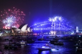 SYDNEY, AUSTRALIA – DECEMBER 31: Fireworks explode over the Sydney Harbour Bridge and the Sydney Opera House in the 9pm display during New Year's Eve celebrations on December 31, 2019 in Sydney, Australia.  (Photo by James Gourley/Getty Images)