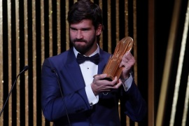 Soccer Football – The Ballon d'Or awards – Theatre du Chatelet, Paris, France – December 2, 2019  Liverpool's Alisson Becker with the Yachine Trophy  REUTERS/Christian Hartmann