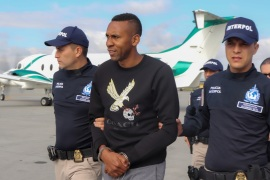 Colombia's former soccer player Jhon Viafara, is escorted by the police, before being extradited to the U.S., to answer for alleged drug trafficking crimes, at an airport in an anti-narcotics base in Bogota, Colombia January 23, 2020. Colombian Police/Handout via REUTERS ATTENTION EDITORS – THIS IMAGE WAS PROVIDED BY A THIRD PARTY
