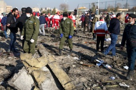 Security officers and Red Crescent workers are seen at the site where the Ukraine International Airlines plane crashed after take-off from Iran's Imam Khomeini airport, on the outskirts of Tehran, Iran January 8, 2020. Nazanin Tabatabaee/WANA (West Asia News Agency) via REUTERS ATTENTION EDITORS – THIS IMAGE HAS BEEN SUPPLIED BY A THIRD PARTY