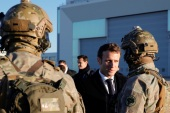 French President Emmanuel Macron talks to soldiers as he visits the 123 Air Base of Orleans-Bricy to give his New Year speech to France's armed forces, in Boulay-les-Barres near Orleans, France January 16, 2020. Cristophe Ena/Pool via REUTERS