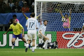 FRANKFURT, GERMANY – JUNE 29: Adriano of Brazil (left) scores his team's fourth goal during the FIFA 2005 Confederations Cup Final between Brazil and Argentina at the Waldstadion on June 29, 2005, in Frankfurt, Germany. (Photo by Christof Koepsel/Bongarts/Getty Images)