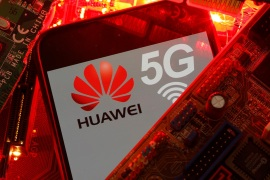 A smartphone with the Huawei and 5G network logo is seen on a PC motherboard in this illustration picture taken January 29, 2020. REUTERS/Dado Ruvic/Illustration