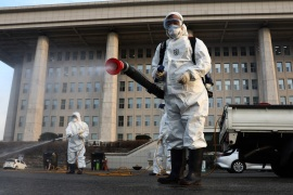 SEOUL, SOUTH KOREA – FEBRUARY 24: Disinfection professionals wear protective gear spray anti-septic solution against the coronavirus (COVID-19) at a National Assembly on February 24, 2020 in Seoul, South Korea. The National Assembly called off its plenary session and temporarily closed its buildings after it was learned that a coronavirus patient attended a parliamentary forum last week. Government has raised the coronavirus alert to the