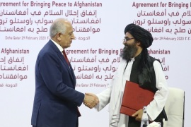 Taliban and US sign landmark peace deal in Doha, Qatar- – QATAR, DOHA – FEBRUARY 29: US Special Representative for Afghanistan Reconciliation Zalmay Khalilzad (L) and Taliban co-founder Mullah Abdul Ghani Baradar (R) shake hands after signing the peace agreement between US, Taliban, in Doha, Qatar on February 29, 2020.