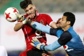 Soccer Football – Egyptian Premier League – Zamalek vs Al Ahly – Cairo International Stadium, Cairo, Egypt – January 8, 2018   Al Ahly's Walid Azaro in action with Zamalek's Ahmed El-Shenawy   REUTERS/Amr Abdallah Dalsh
