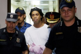 Judge rules Ronaldinho must remain in Paraguayan jail – Paraguayan Supreme Court, Asuncion, Paraguay – March 7, 2020? Ronaldinho handcuffed and escorted by police at the Supreme Court of Paraguay?REUTERS/Jorge Adorno