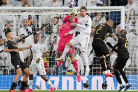 Soccer Football – Champions League – Round of 16 First Leg – Real Madrid v Manchester City – Santiago Bernabeu, Madrid, Spain – February 26, 2020  Manchester City's Ederson in action with Real Madrid's Sergio Ramos  REUTERS/Susana Vera