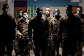Members of Joint Task Force 2, composed of soldiers and airmen from the New York Army and Air National Guard, work to sanitize the New Rochelle High School during the coronavirus disease (COVID-19) outbreak in New Rochelle, New York, U.S., March 21, 2020. REUTERS/Andrew Kelly     TPX IMAGES OF THE DAY