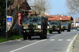 Coffins of coronavirus victims from the church of San Giuseppe- – SERIATE, ITALY – MARCH 28: The Italian military vehicles carry the coffins of coronavirus (COVID-19) pandemic victims from the church of San Giuseppe to the crematorium on March 28, 2020 in Seriate, Italy.
