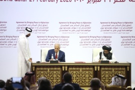 Taliban and US sign landmark peace deal in Doha, Qatar- – QATAR, DOHA – FEBRUARY 29: US Special Representative for Afghanistan Reconciliation Zalmay Khalilzad (L) and Taliban co-founder Mullah Abdul Ghani Baradar (R) sign a peace agreement between US, Taliban, in Doha, Qatar on February 29, 2020.