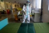 A worker in protective suit disinfects the Wuhan No. 7 Hospital, once a designated hospital for coronavirus disease (COVID-19) patients, to prepare it for the resumption of its normal service in Wuhan, Hubei province, China March 19, 2020. cnsphoto via REUTERS   ATTENTION EDITORS – THIS IMAGE WAS PROVIDED BY A THIRD PARTY. CHINA OUT.