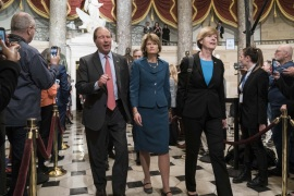 WASHINGTON, DC – FEBRUARY 04: Sen. Tom Udall (D-NM), Sen. Lisa Murkowski (R-AK) and Sen. Tammy Baldwin (D-WI) walk through Statuary Hall to the House Chamber for the State of the Union on February 4, 2020 in Washington, DC. President Trump delivers his third State of the Union to the nation the night before the U.S. Senate is set to vote in his impeachment trial.   Sarah Silbiger/Getty Images/AFP== FOR NEWSPAPERS, INTERNET, TELCOS & TELEVISION USE ONLY ==