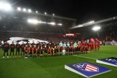 LIVERPOOL, ENGLAND – MARCH 11: The two teams line up before the UEFA Champions League round of 16 second leg match between Liverpool FC and Atletico Madrid at Anfield on March 11, 2020 in Liverpool, United Kingdom. (Photo by Julian Finney/Getty Images)