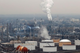 General view of oil tanks and the Bayway Refinery of Phillips 66 in Linden, New Jersey, U.S., March 30, 2020. REUTERS/Mike Segar REFILE – CORRECTING REFINERY NAME