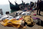 epa08210785 A view of victims' bodies covered in sheets lying on a quay after a trawler capsized off the Bay of Bengal, in Teknaf, Cox's Bazar District, Bangladesh, 11 February 2020. According to local media reports, at least 15 Rohingya refugees died after a trawler on its way to Malaysia sank off the coast in the Bay of Bengal, near St Martin's Island. Some 65 people were said to have been rescued alive, media added. The victims are said to be mostly women from Rohingya camps located in Teknaf and Ukhia Upazila of Cox's Bazar.  EPA-EFE/STRINGER