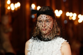 A model wears a black veiled fascinator with bow and a sleeveless white silk adorned top, at the Giambattista Valli fashion show, where the designer presented his collection created in collaboration with fast-fashion giant H&M, in Rome, Italy October 24, 2019. Picture taken October 24, 2019. REUTERS/Remo Casilli