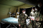 French soldiers, wearing protective face masks, install tents at a miitary field hospital near Mulhouse hospital as France faces an aggressive progression of the coronavirus disease (COVID-19), March 23, 2020. REUTERS/Christian Hartmann