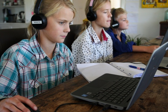 TARPOLY CREEK, AUSTRALIA – APRIL 05: Alessia Bowman, 10, Sybella Bowman, 12, and Oliver Bowman, 8, do school work at their family home and cattle property on April 05, 2020 in Tarpoly Creek, Australia. Emily Bowman, mother of three, believes the current internet situation highlights