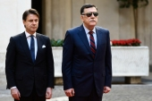 "Italian Prime Minister Giuseppe Conte (L) and Chairman of the Presidential Council of Libya and Prime Minister of the Government of National Accord (GNA) of Libya, Fayez al-Sarraj stand at atention during a welcoming ceremony upon Farraj's arrival for their meeting on May 7, 2019 in Rome. – Libya's internationally recognised government said its head Fayez al-Sarraj will tour Europe, starting a series of meetings with the leaders of Italy, Germany, France and possibly Britain to seek support against an attack on Tripoli by strongman Khalifa Haftar, who urged his troops to ""wipe out"" government forces. (Photo by Filippo MONTEFORTE / AFP)"