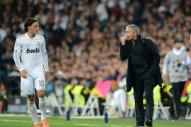 MADRID, SPAIN – APRIL 25:  Head Coach Jose Mourinho of Real Madrid has words with Mesut Ozil of Real Madrid during the UEFA Champions League Semi Final second leg between Real Madrid CF and Bayern Munich at The Bernabeu Stadium on April 25, 2012 in Madrid, Spain.  (Photo by Jasper Juinen/Getty Images)