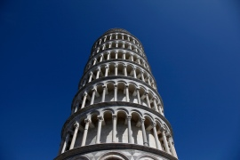 The Leaning Tower of Pisa is seen against blue skies