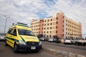 Ambulance drives past the Suez Canal University hospital, where victims of the Al Rawdah mosque attack are being treated in Ismailia