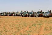 Members of Sudan's paramilitary Rapid Support Forces (RSF) stand next to vehicles in Khartoum