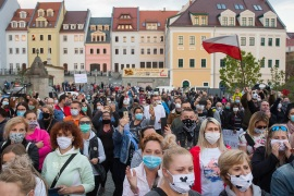 ZGORZELEC, POLAND – 2020/04/24: Protesters wearing protective masks march on the street during the demonstration. Hundreds of polish-Germany border residents protest against anti-virus measures as they block them from commuting to work on a daily basis. In response to the COVID-19 pandemic, both countries are requiring those entering to undergo a 14day quarantine period, though Germany makes an exception for cross border commuters, Poland does not. (Photo by Karol Serewis/SOPA Images/LightRocket via Getty Images)