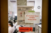 Scientists work in a lab testing COVID-19 samples at New York City's health department, during the outbreak of the coronavirus disease (COVID-19) in New York City, New York U.S., April 23, 2020. Picture taken April 23, 2020. REUTERS/Brendan McDermid