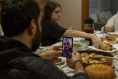 DEARBORN, MI – APRIL 24: Abbas Al Haj Ahmed talks with his cousin Adam Bazzi over a video call while their family shares a meal and breaks fast on the first full day of Ramadan on April 24, 2020 in Dearborn, Michigan. Due to the social distancing guidelines being enforced to combat the spread of the coronavirus (COVID-19) the Muslim holy month of Ramadan is going to be observed differently this year amidst the pandemic.   Elaine Cromie/Getty Images/AFP== FOR NEWSPAPERS, INTERNET, TELCOS & TELEVISION USE ONLY ==
