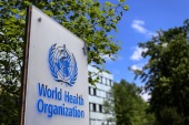 This picture taken on April 24, 2020 shows a sign of the World Health Organization (WHO) in Geneva next to their headquarters, amid the COVID-19 outbreak, caused by the novel coronavirus. (Photo by Fabrice COFFRINI / AFP)