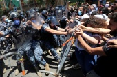 Protesters confront with riot police in Beirut
