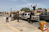 Fighters loyal to Libya's internationally recognised government celebrate after regaining control over Tripoli