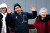 Rezaian one of the U.S. citizens recently released from detention in Iran waves to media outside the Emergency Room of the LRMC in the southwestern town of Landstuhl