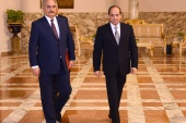 Libyan military commander Khalifa Haftar walks with Egyptian President Abdel Fattah al-Sisi at the Presidential Palace in Cairo