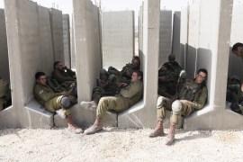 فترة استراحة لجنود إسرائيليين خلال تدريب عسكري (غيتي-أرشيف)