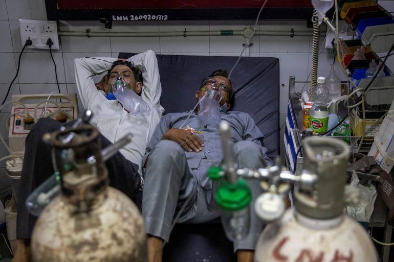 حالات كورونا اليومية بالهند تقفز لمستوى عالمي قياسي والمستشفيات تئن وسويسرا  تسجل أول إصابة بالنسخة الهندية المتحورة