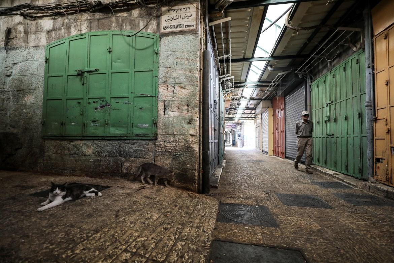 المحالّ التجارية في البلدة القديمة في القدس المحتلة مغلقة يوم الإضراب (رويترز)