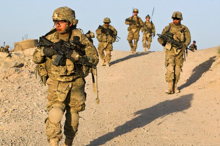 ناشونال إنترست: الهيمنة العسكرية الأميركية كانت كارثية للشرق الأوسط وأميركا جنود من الجيش الأمريكي في مدينة قندهار (رويترز- أ 000-5