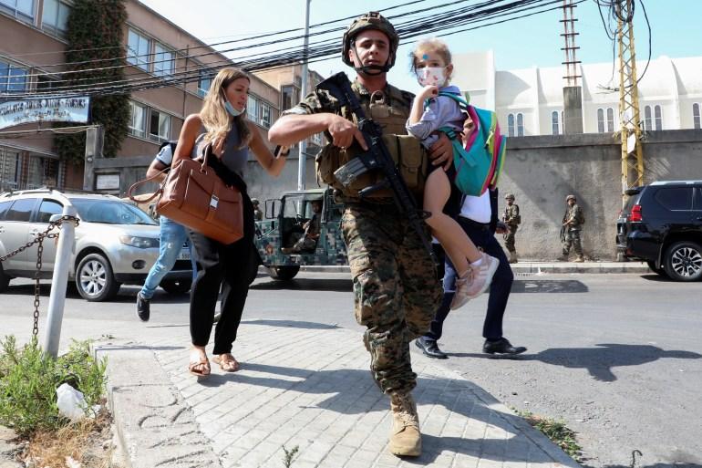 Civilians flee after gunfire erupted in Beirut